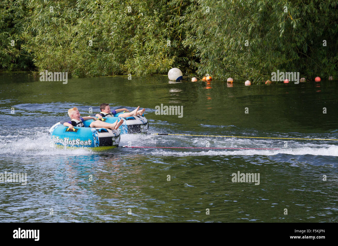 Children messing about on the river lake in ringos - Stock Image