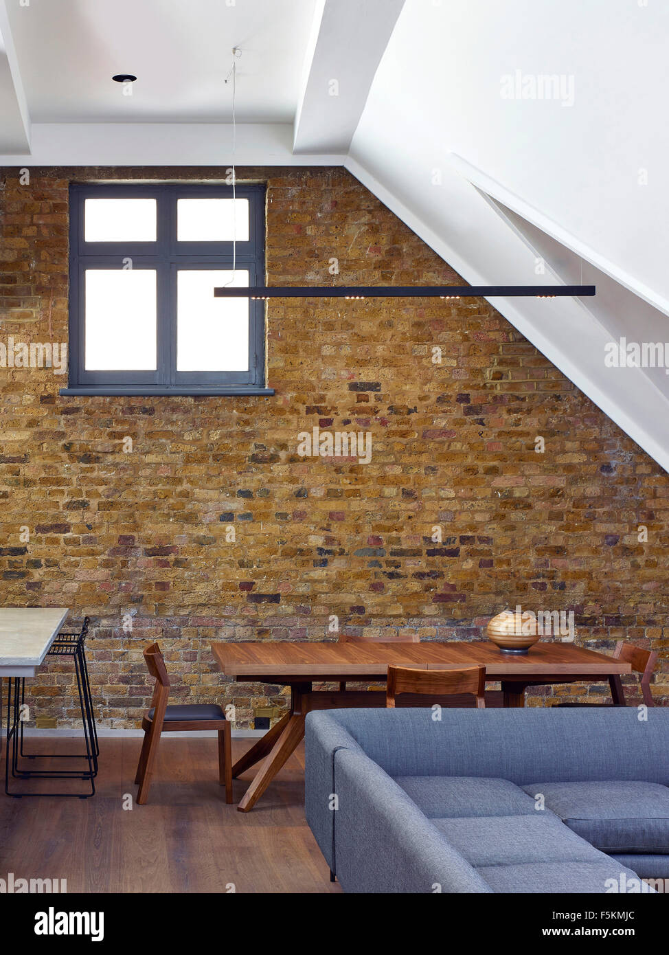 exposed brick wall in living area mandeville apartment london united kingdom architect neil davies architects 2015
