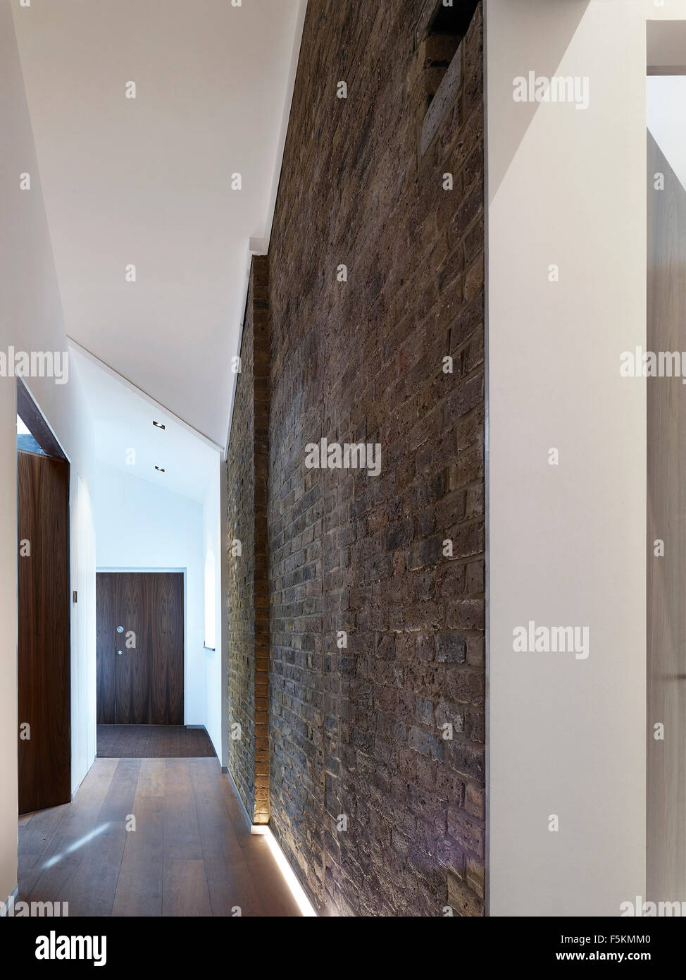 corridor perspective with exposed brick mandeville apartment london united kingdom architect neil davies architects 2015