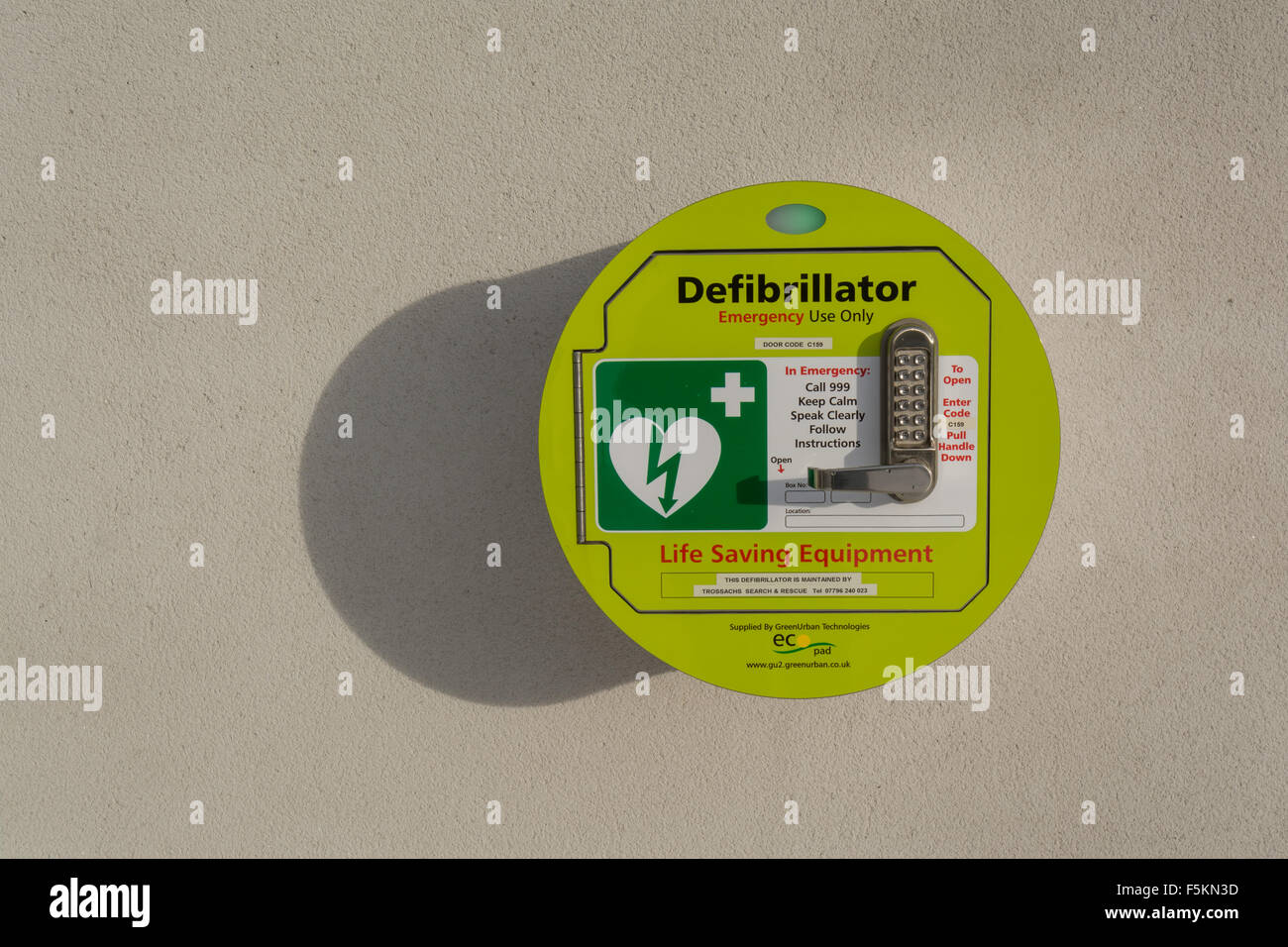 Public Access Defibrillator attached to the wall outside Killearn village hall, Stirlingshire, Scotland, UK - Stock Image