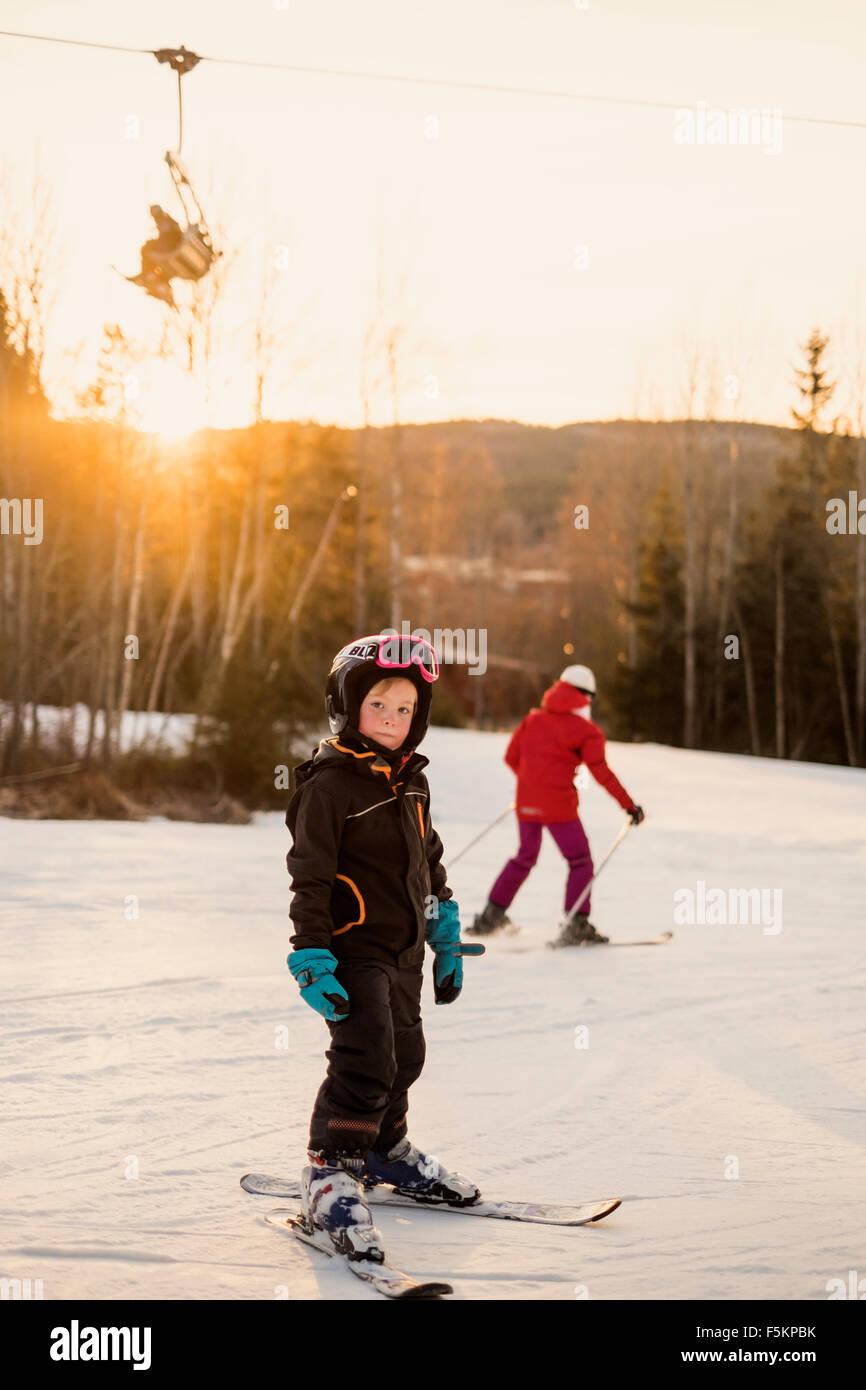 Sweden, Dalarna, Salen, Portrait of girl (4-5) smiling on ski slope - Stock Image