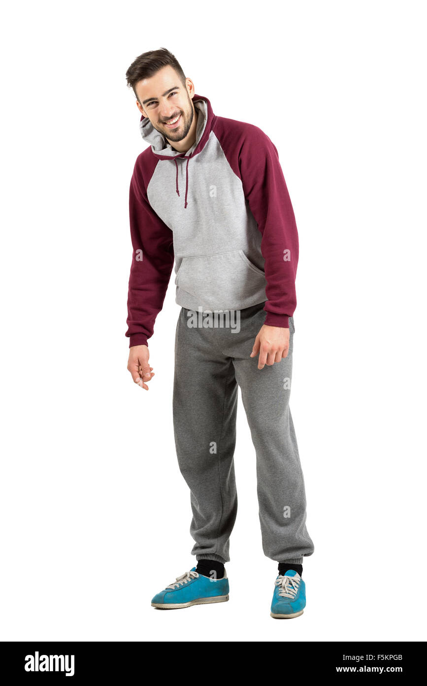 full body hoodie young man in sporty hoodie spontaneously laughing at 8079