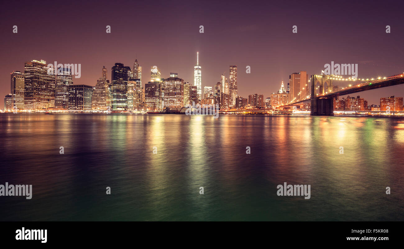 Vintage toned Manhattan waterfront at night, New York City, USA. - Stock Image