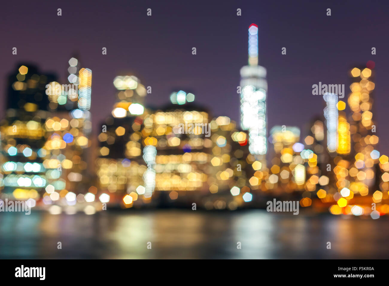 Blurred Manhattan waterfront at night, New York City, USA. - Stock Image