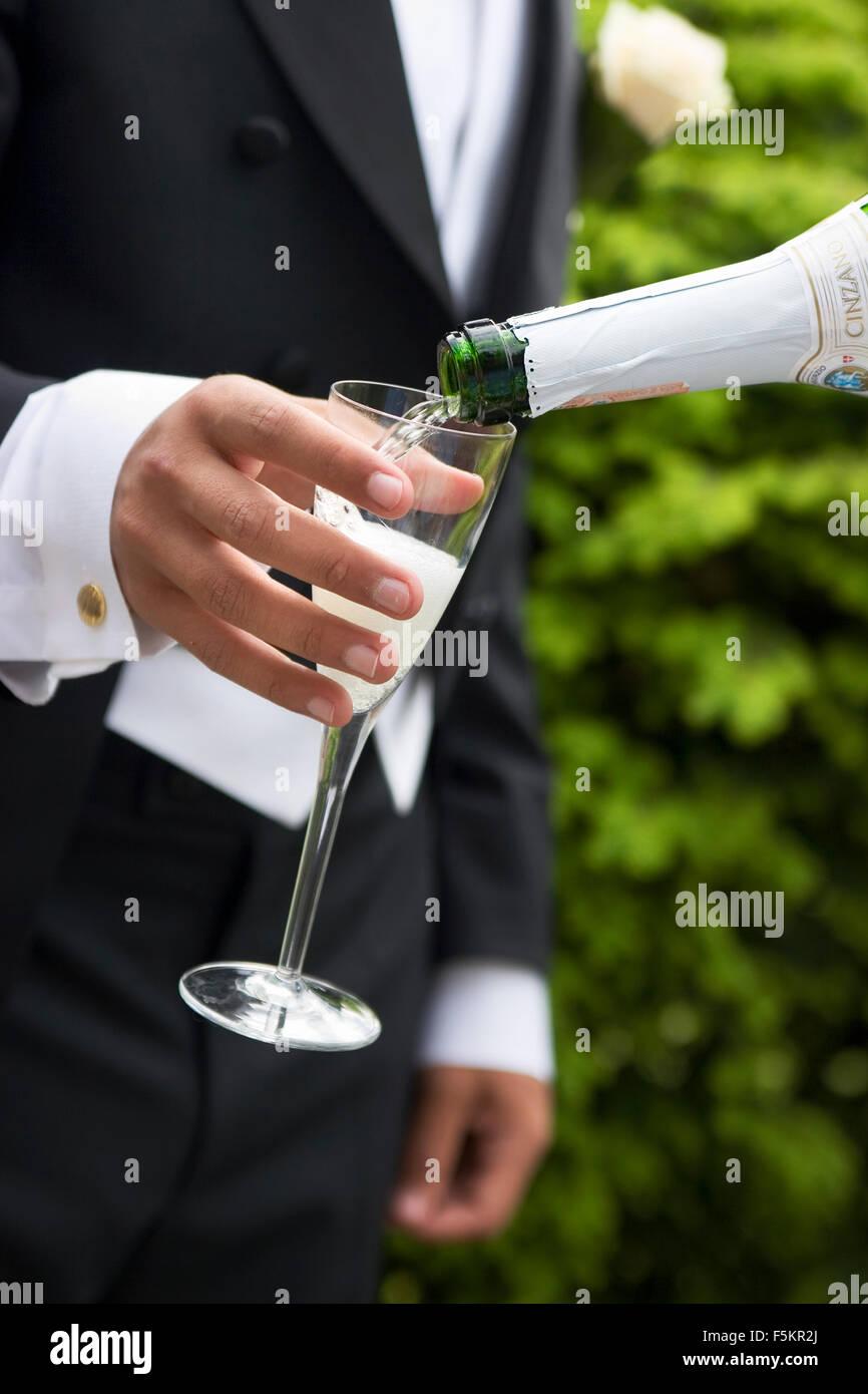 Sweden, Vastra Gotaland, Gothenburg, Groom holding champagne flute - Stock Image