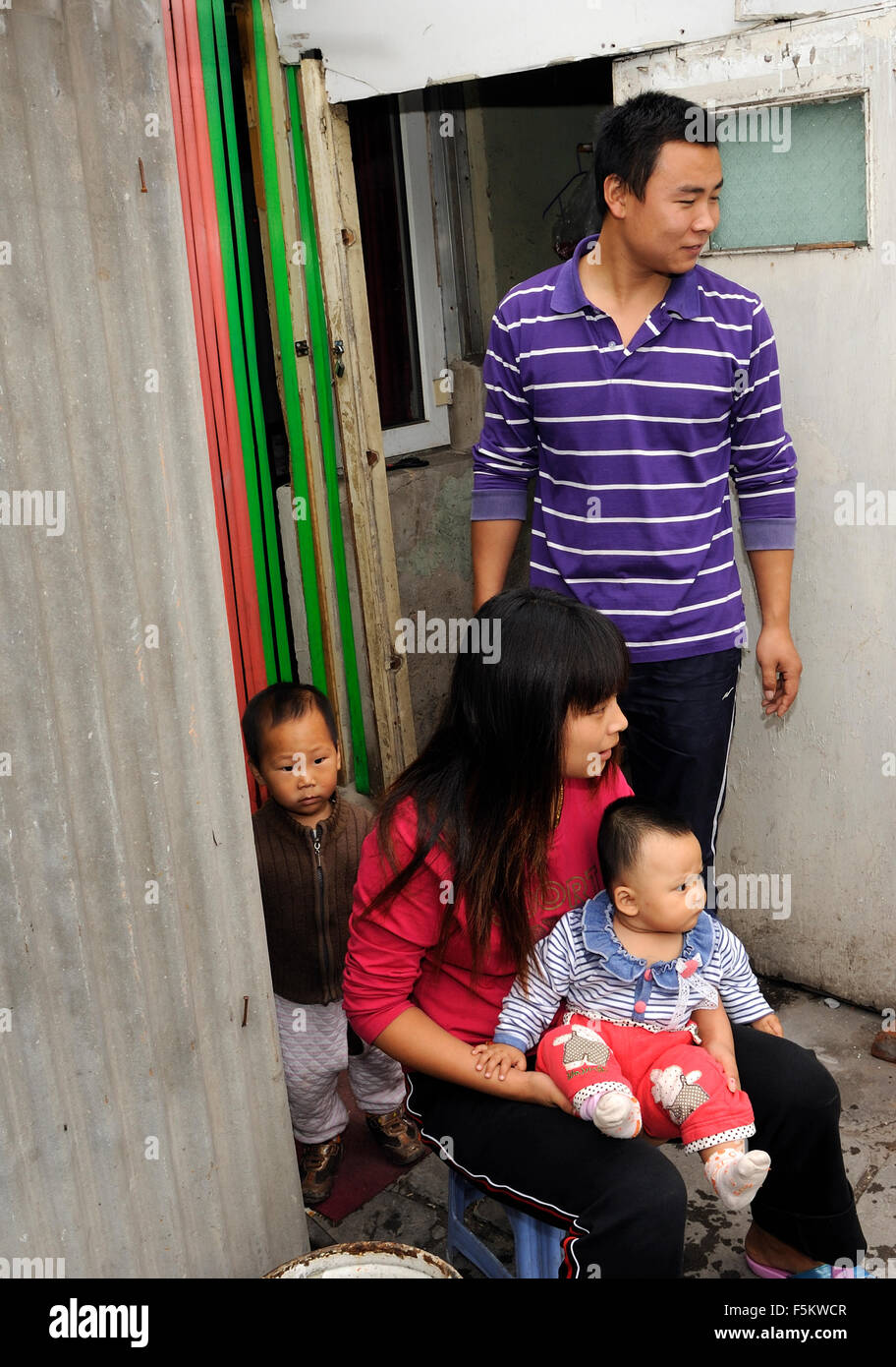 A family with two children in Beijing, China. - Stock Image