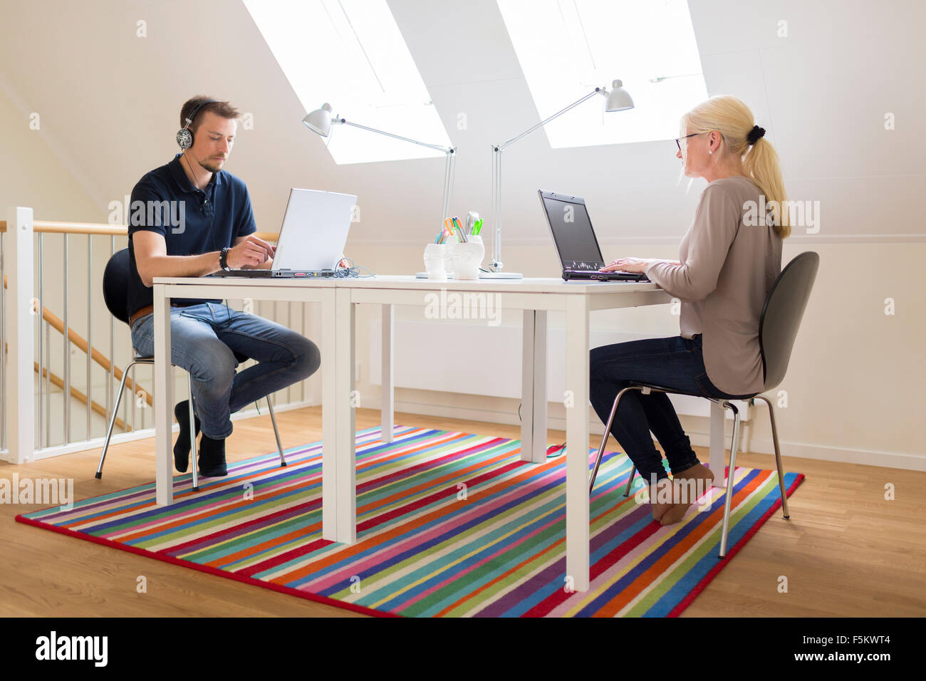 Sweden, Couple working at home - Stock Image