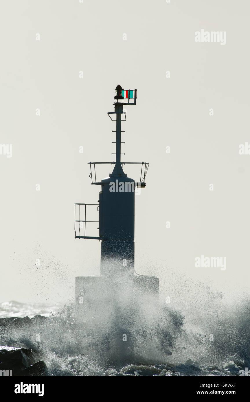 Sweden, Halland, Morup, Lighthouse and splashing waves Stock Photo