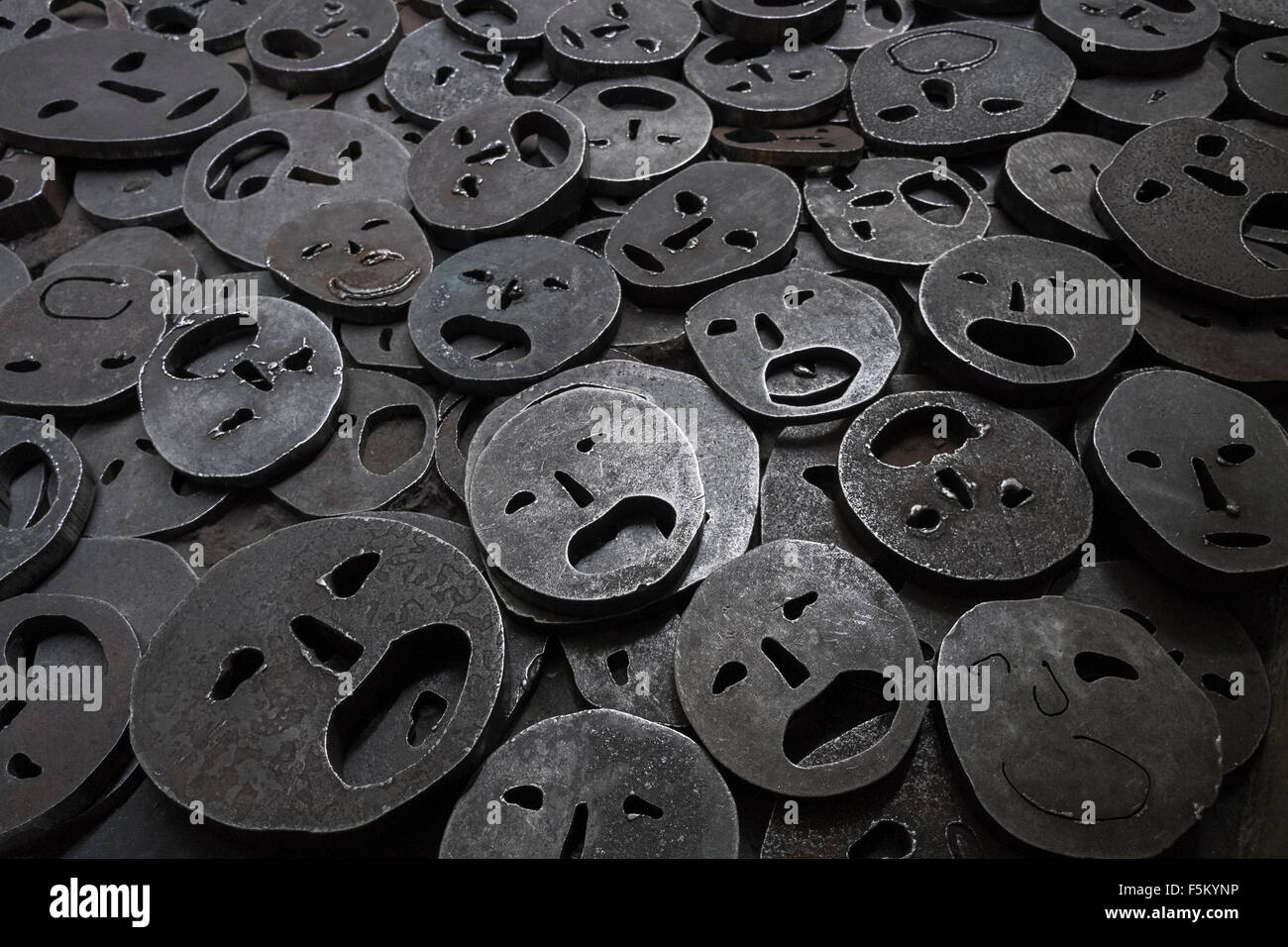 Close up detail of steel faces by artist Menashe Kadishman, exhibited in the Memory Void, Jewish Museum, Berlin, - Stock Image