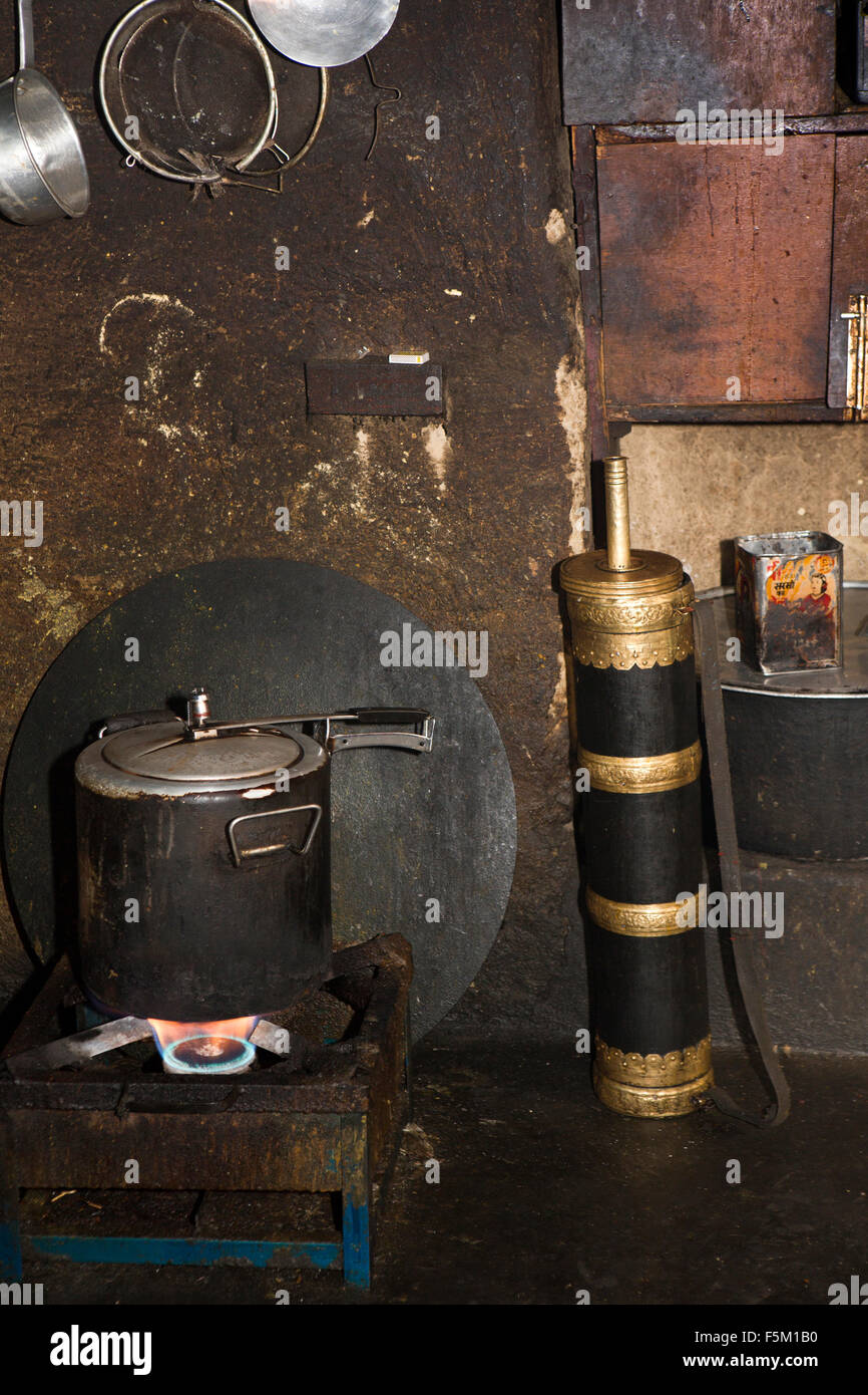 India, Himachal Pradesh, Spiti Valley, Key Monastery kitchen, pressure cooker & traditional brass bound butter - Stock Image