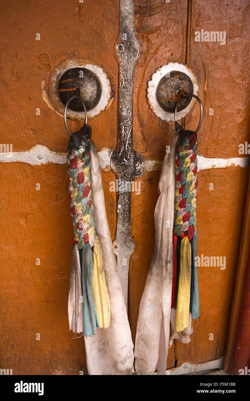 India, Himachal Pradesh, Spiti Valley, Key Monastery, decorative plaited cloth textile pulls on temple door - Stock Image