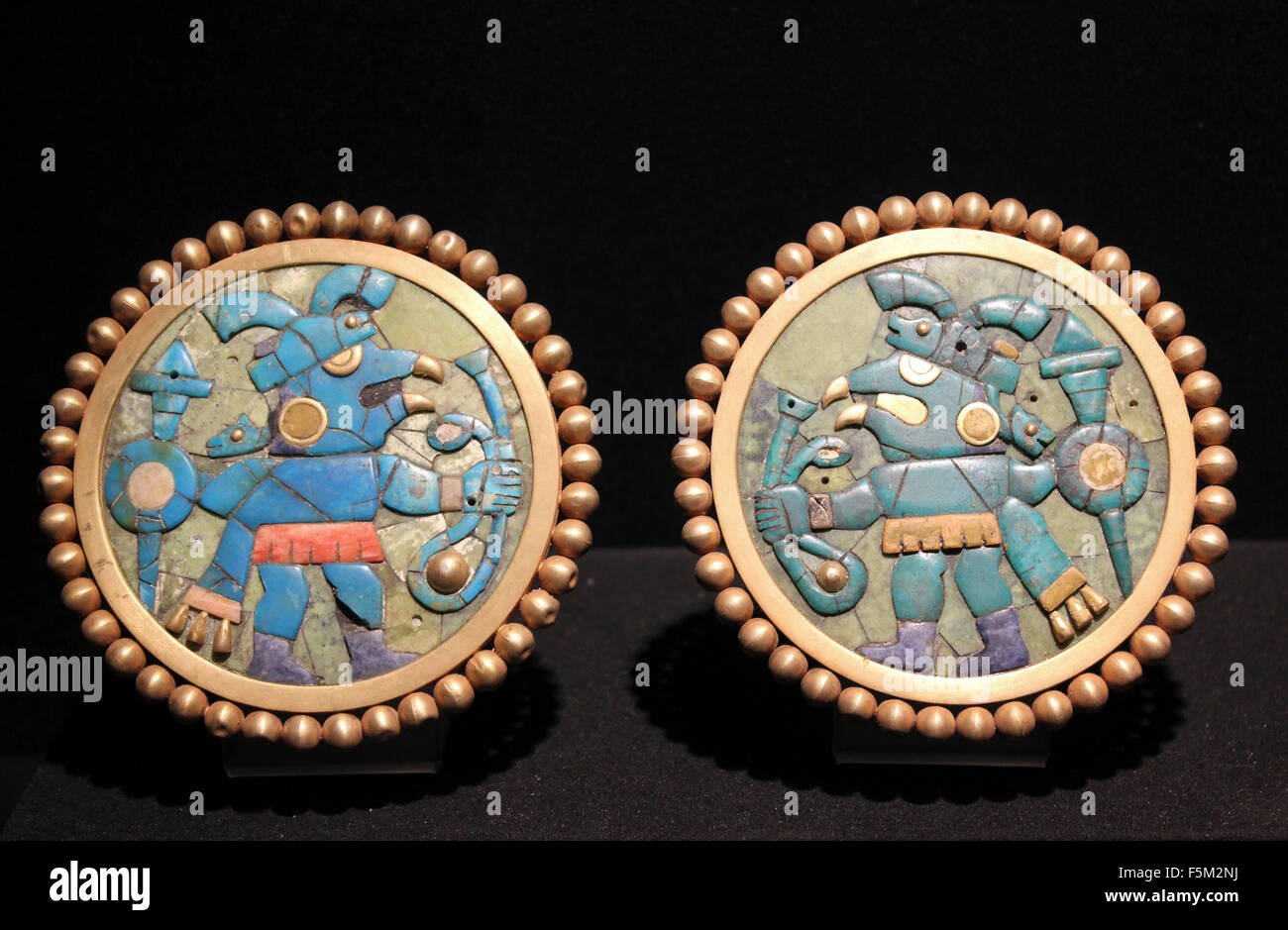 Gold Ear Ornaments Inlaid with Turquoise, Sodalite and Shell - Moche, Florescent Epoch 1 AD - 800 AD - Stock Image