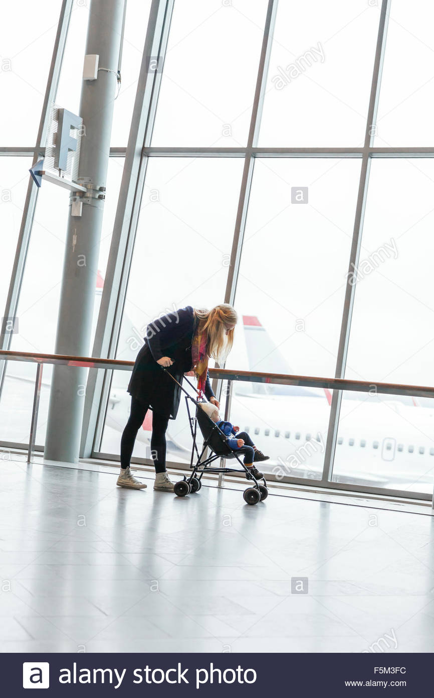 Sweden, Uppland, Stockholm Arlanda airport, Woman with son (12-17 months) - Stock Image