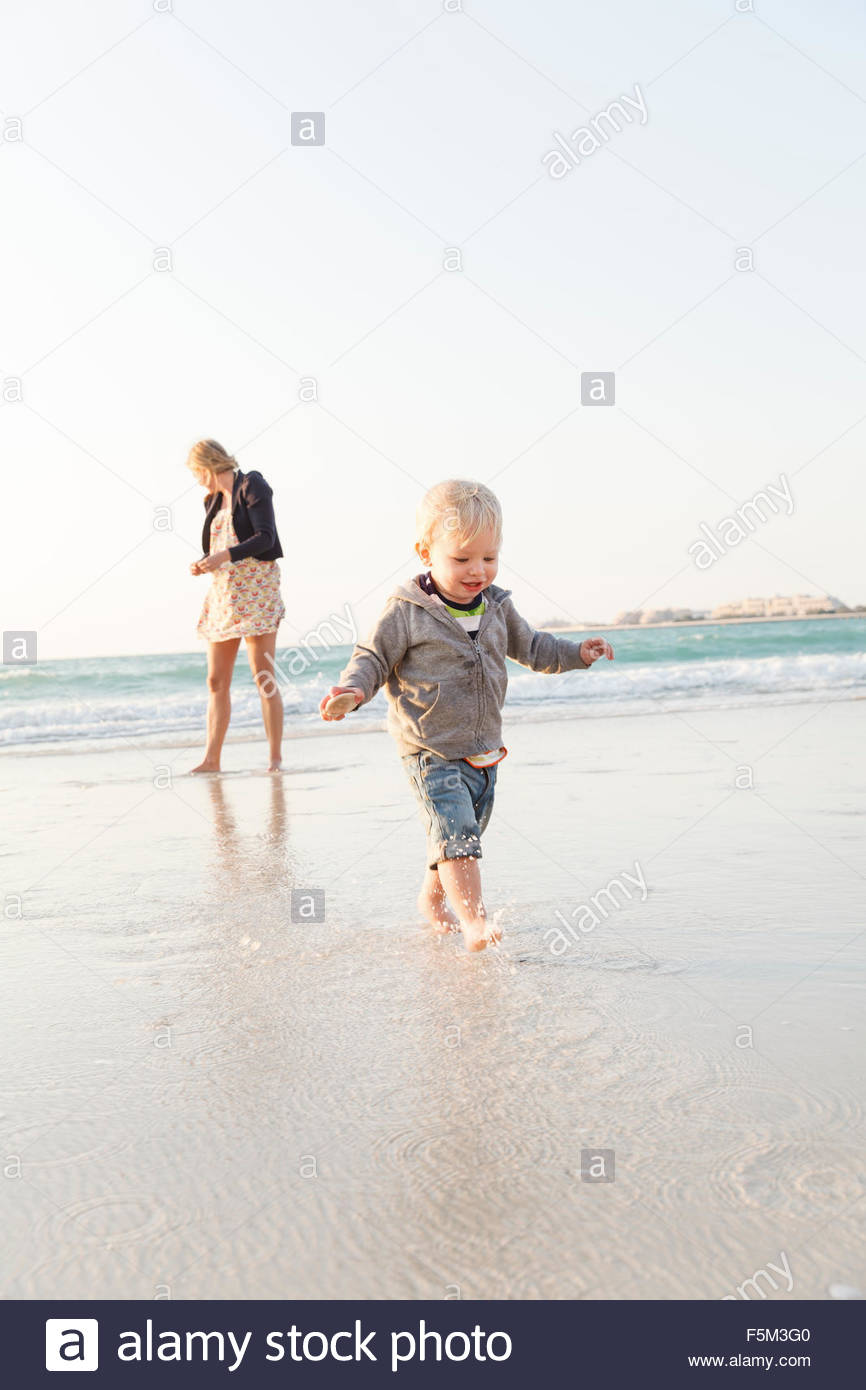 United Arab Emirates, Dubai, Woman with son (12-17 months) on beach Stock Photo