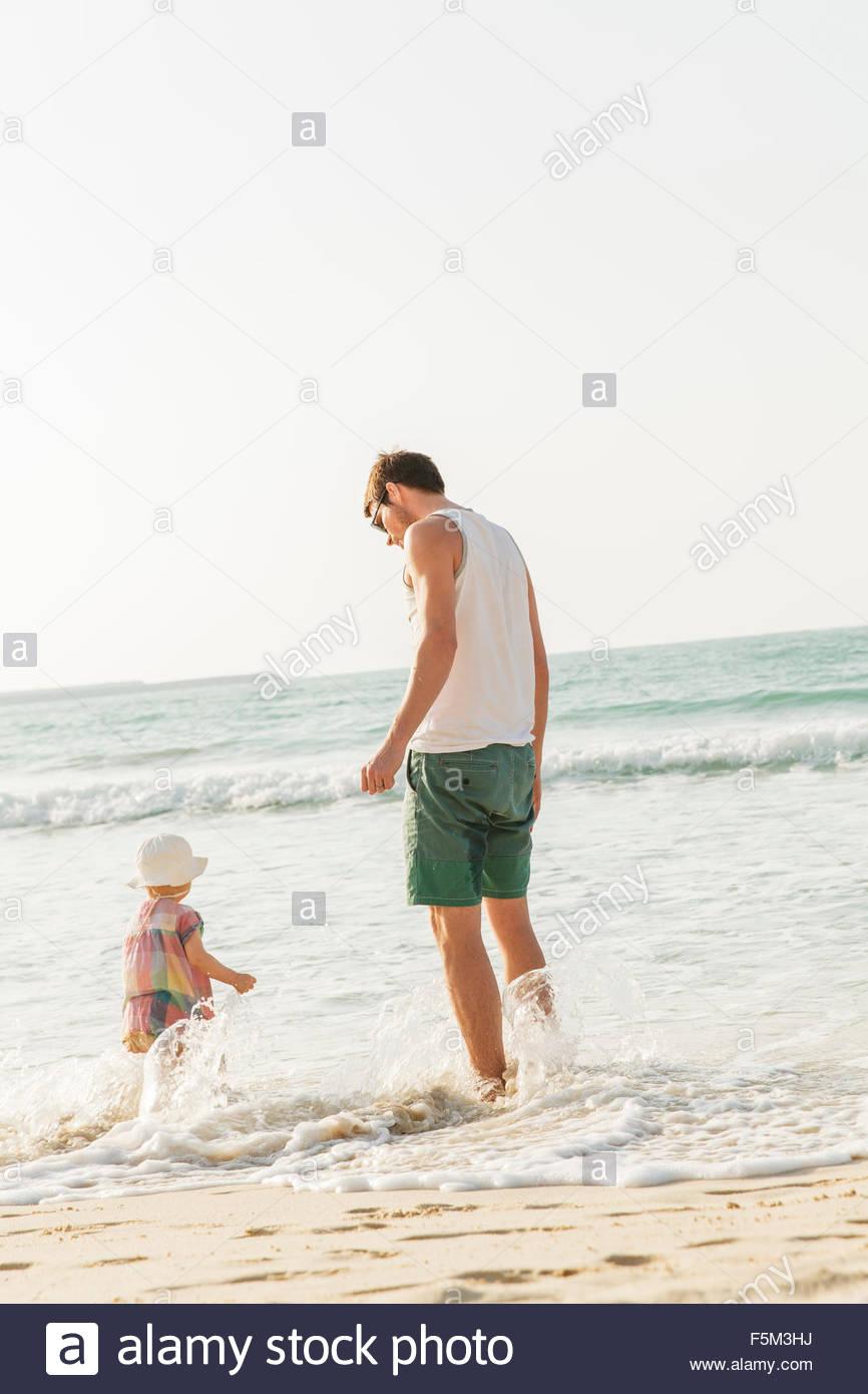 United Arab Emirates, Dubai, Man with son (2-3) on beach - Stock Image