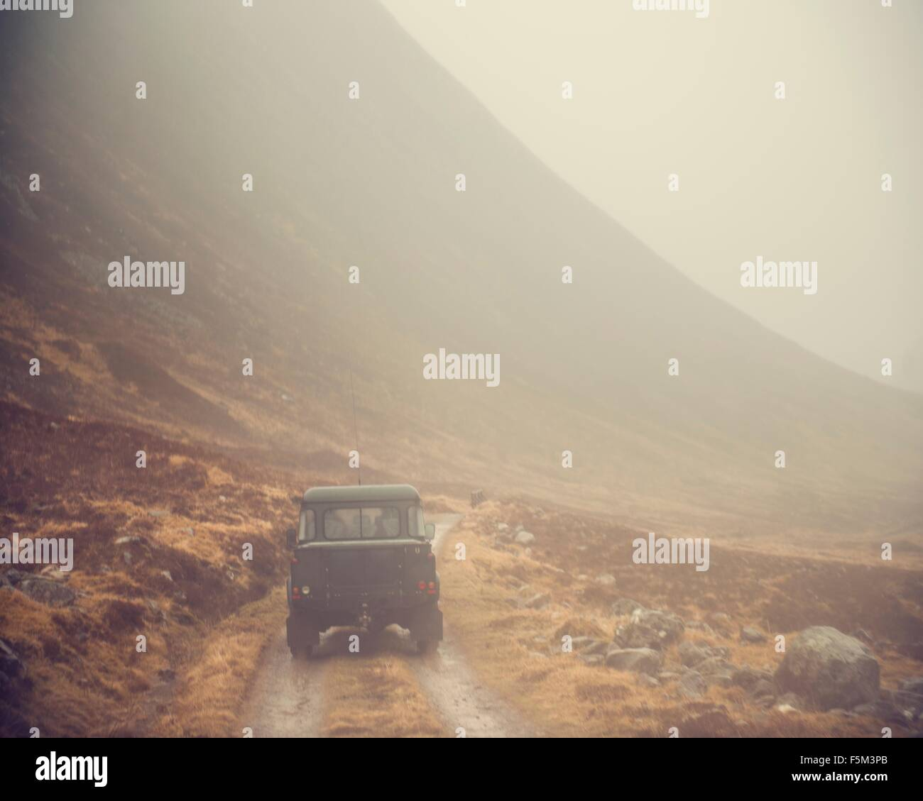 Four wheeled drive on mountain valley dirt track, Sutherland, Scotland - Stock Image