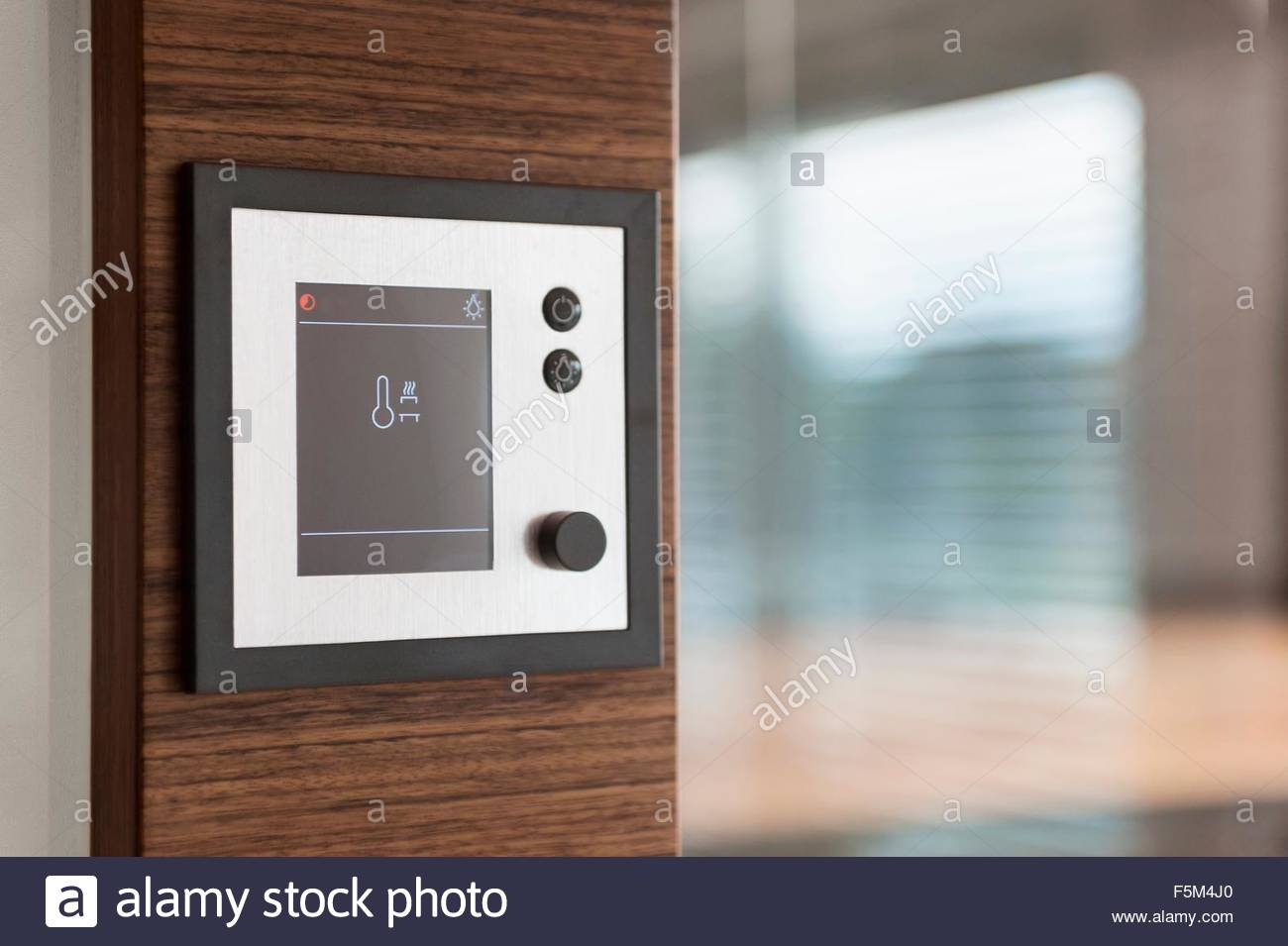 Temperature control panel of home automation system - Stock Image