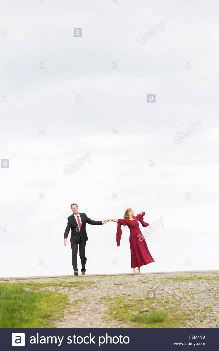 Denmark, Zealand, Store Heddinge, Couple on dirt road against sky - Stock Image