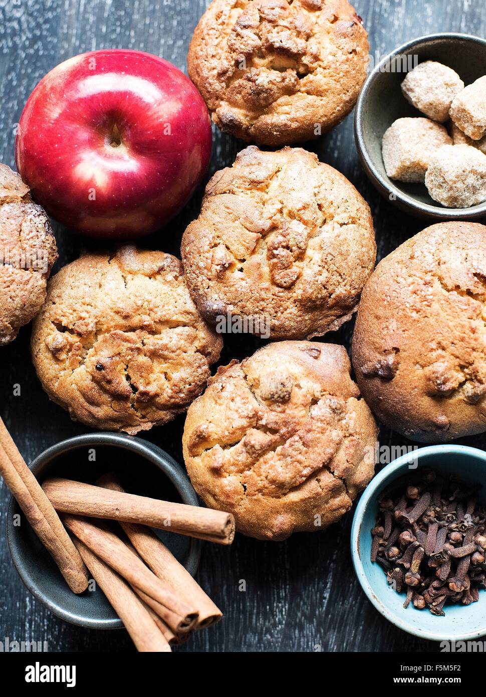 Muffins with apple, cinnamon and cloves, overhead view - Stock Image