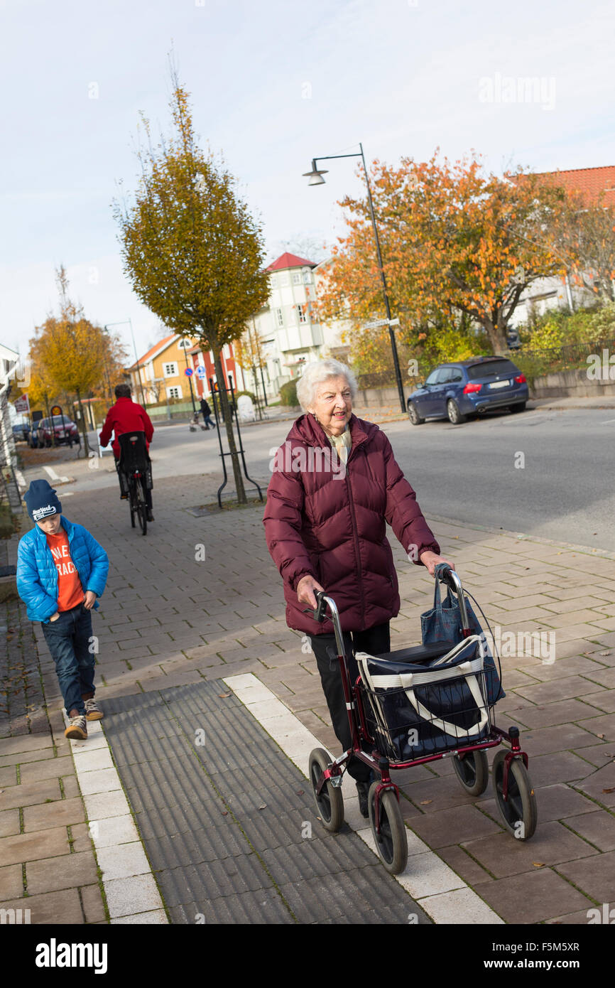 Sweden, Smaland, Tingsryd, Boy (6-7) walking with great-grandmother Stock Photo