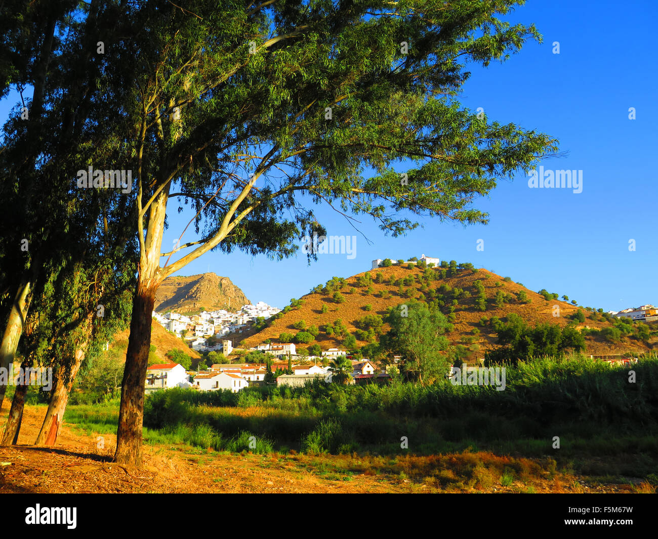 White Village of Alora Andalucia viewed from across the Guadalhorce River - Stock Image