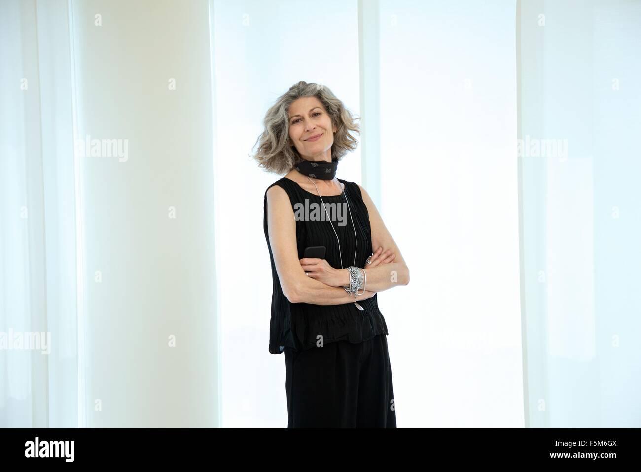 Portrait of stylish senior female designer in office - Stock Image