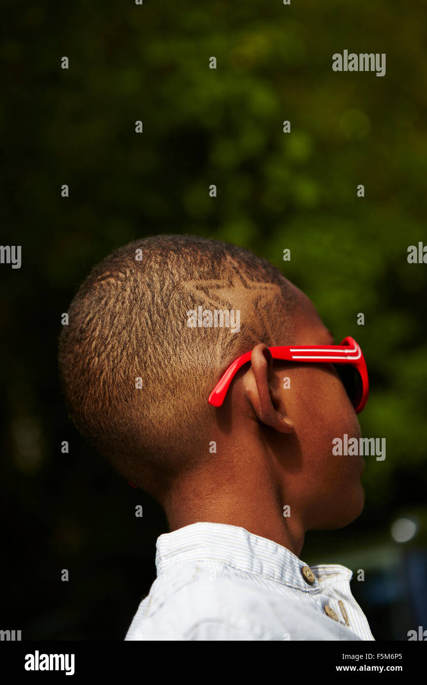 Sweden, Vastra Gotaland, Boy (10-11) with star shape haircut - Stock Image