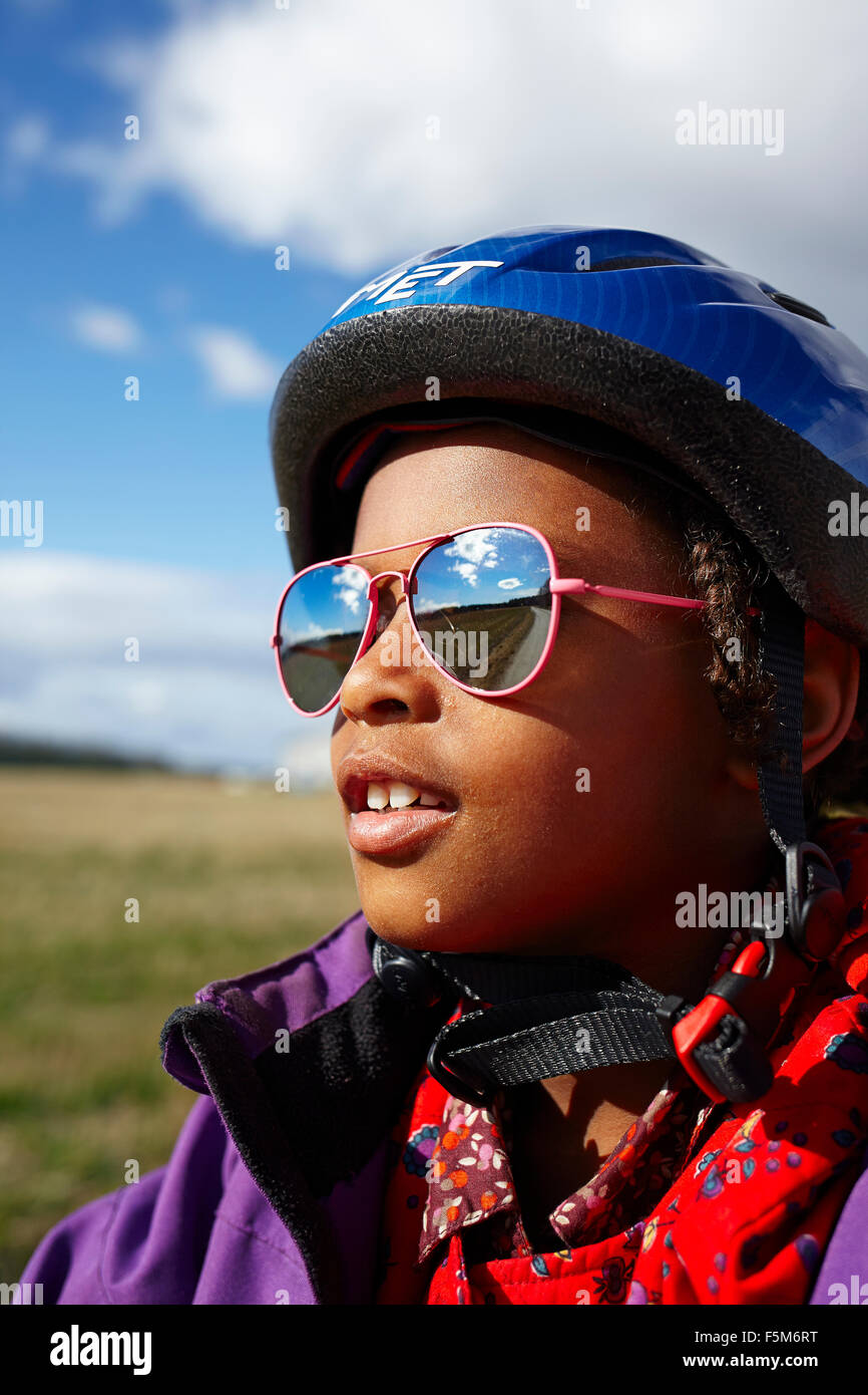 Sweden, Vastra Gotaland, Gullspang, Runnas, Portrait of girl (6-7) in cycling helmet and sunglasses - Stock Image