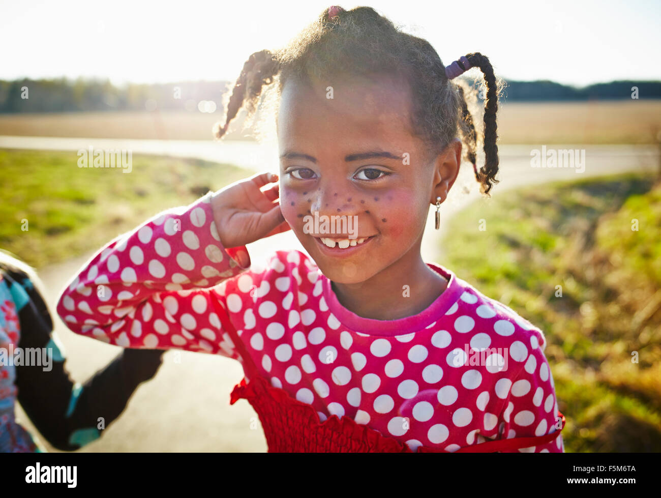 Sweden, Vastra Gotaland, Gullspang, Runnas, Girl (6-7) with painted freckles - Stock Image