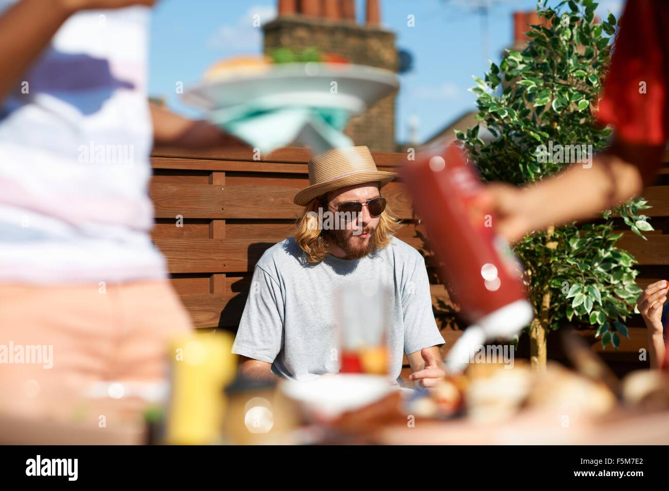 People at a rooftop party - Stock Image