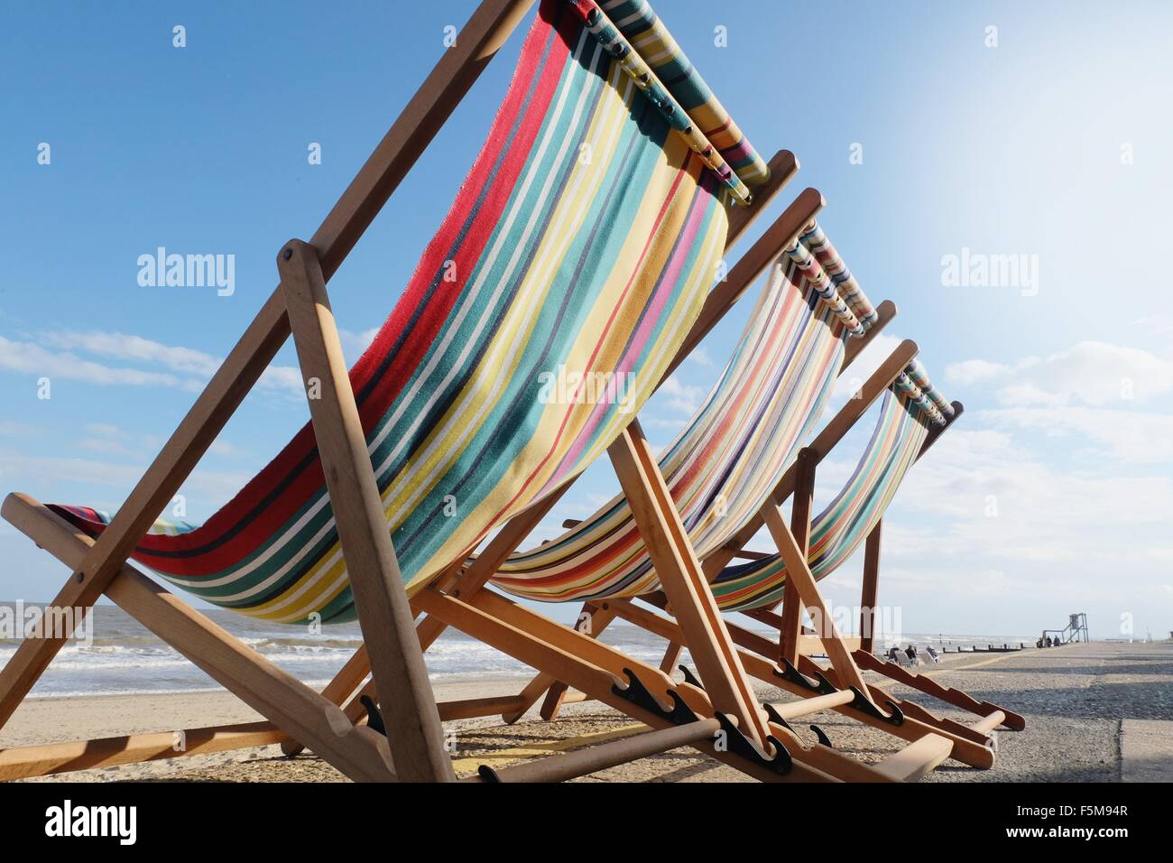Three empty deckchairs, rear view, low angle view - Stock Image