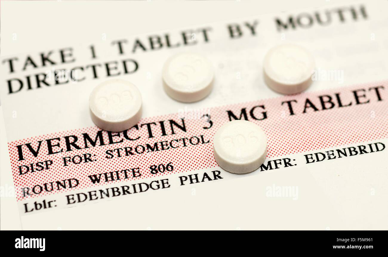 Ivermectin pills (a broad-spectrum antiparasitic agent) on top of instruction label - Stock Image
