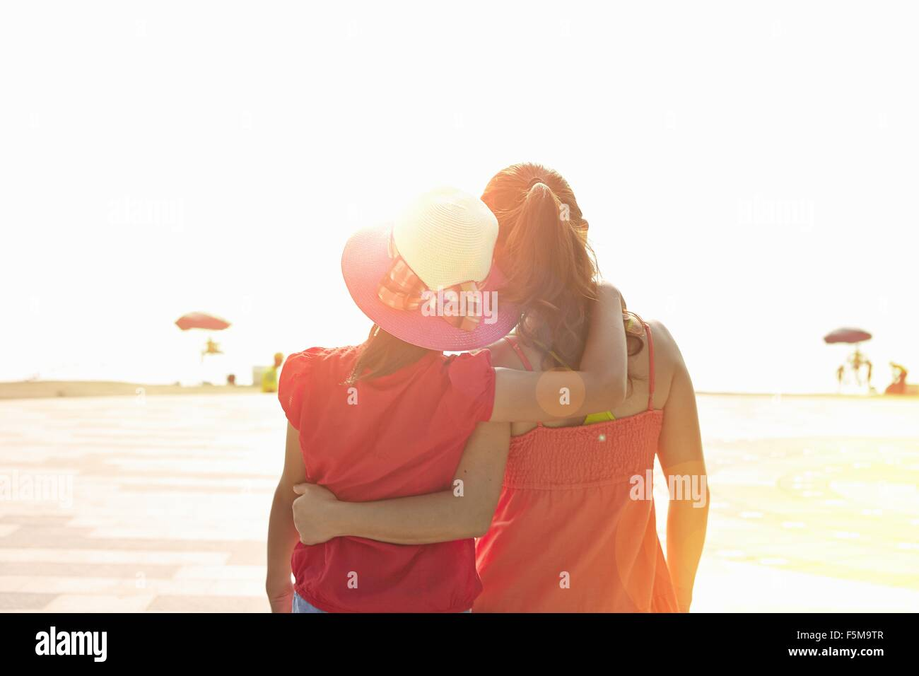 Rear view of mid adult woman and daughter on beach, Zhuhai, Guangdong, China - Stock Image