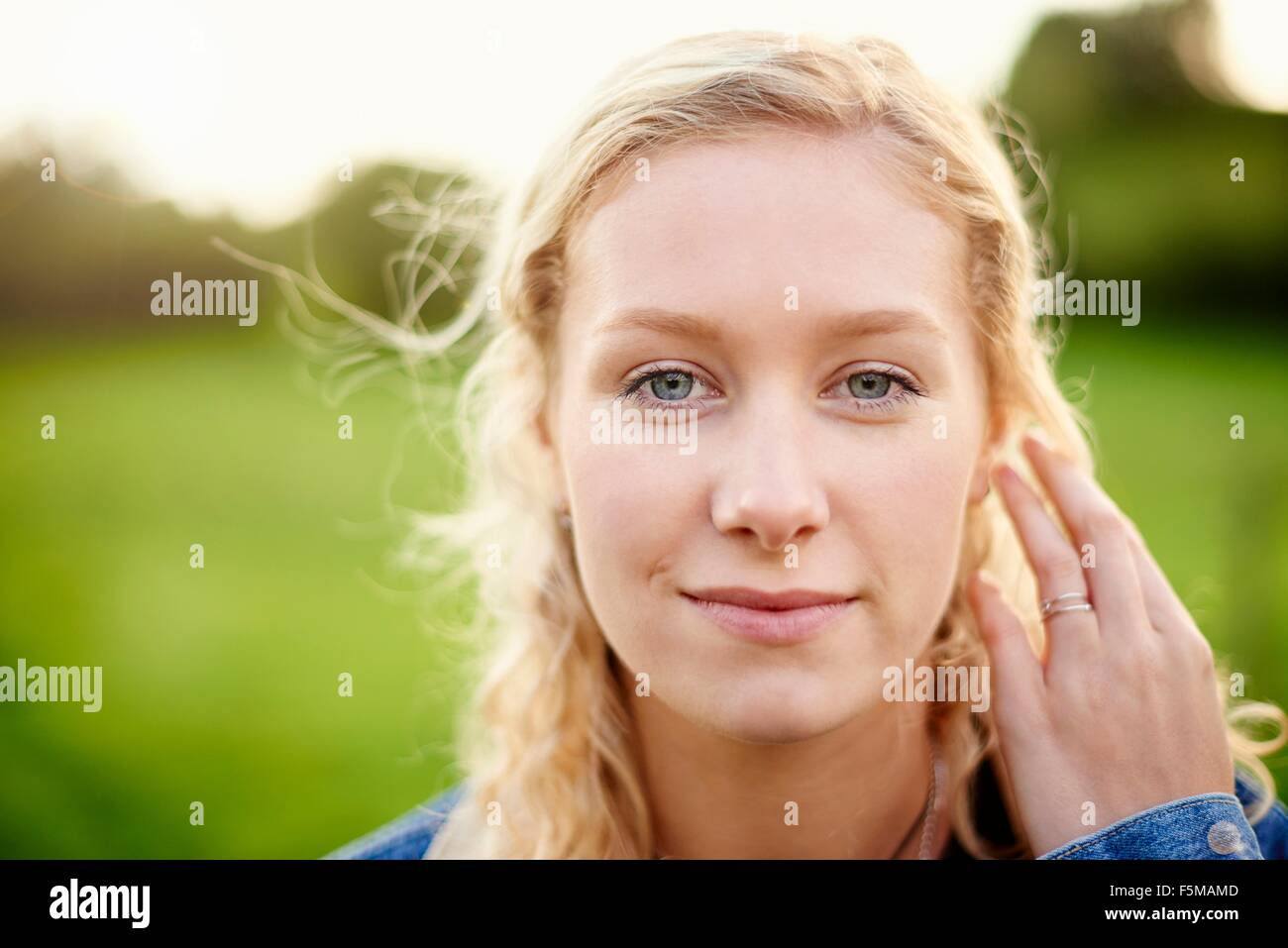 Close up portrait of young woman with blond hair - Stock Image
