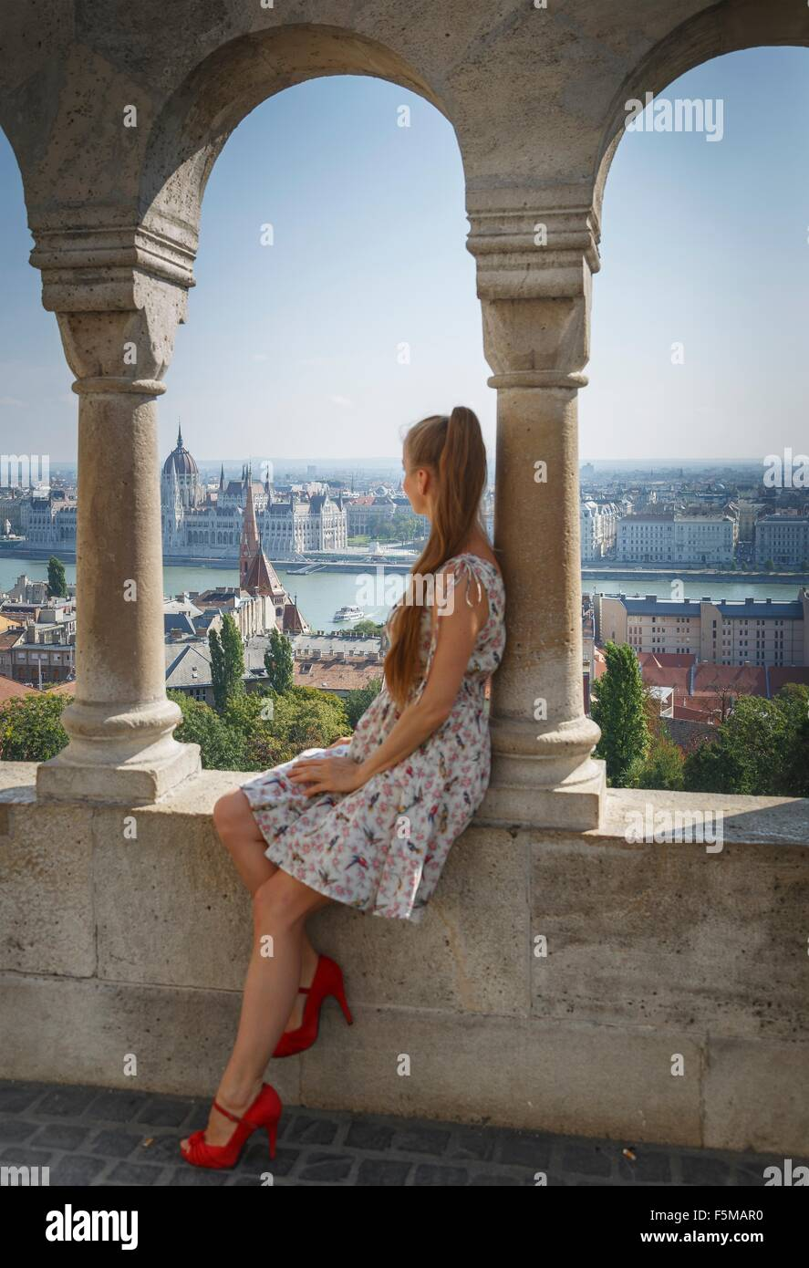 Mid adult woman looking at view of Buda from the Fisherman's Bastion, Budapest, Hungary - Stock Image