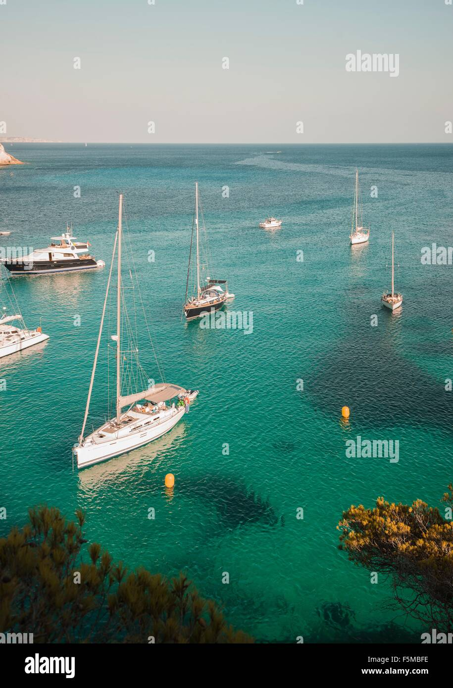 Yachts anchored in bay at Cala Macarella, Menorca, Spain Stock Photo