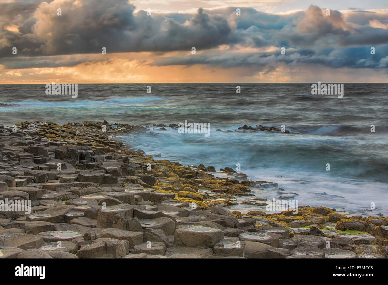 High angle view of Giants Causeway, ocean and dramatic sky, Bushmills, County Antrim, Ireland, UK - Stock Image