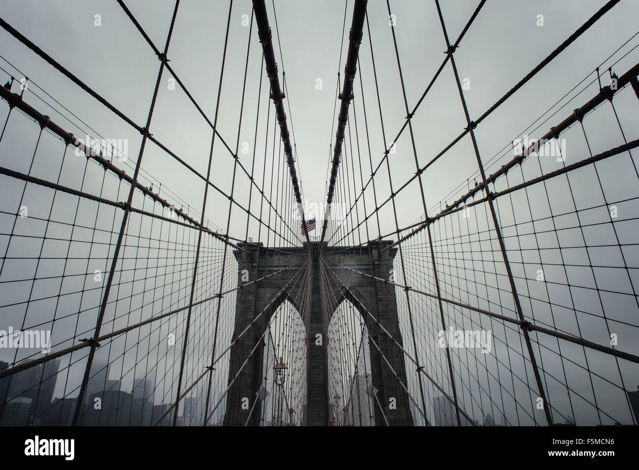Low angle view of Brooklyn Bridge symmetry, New York, USA - Stock Image