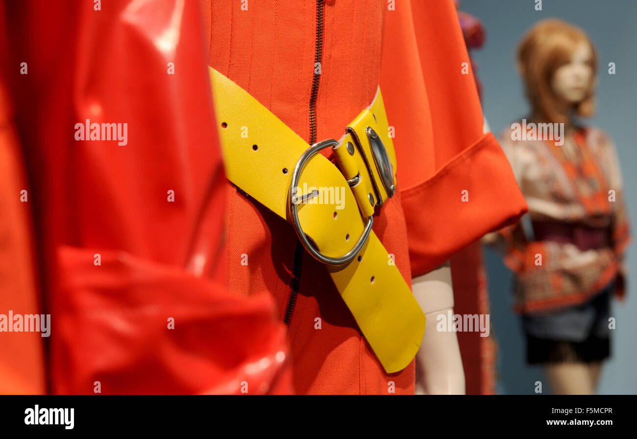 Red leather and a yellow belt on show at the new exhibition 'Demo, Derrick, Discofieber - Die siebziger Jahre - Stock Image