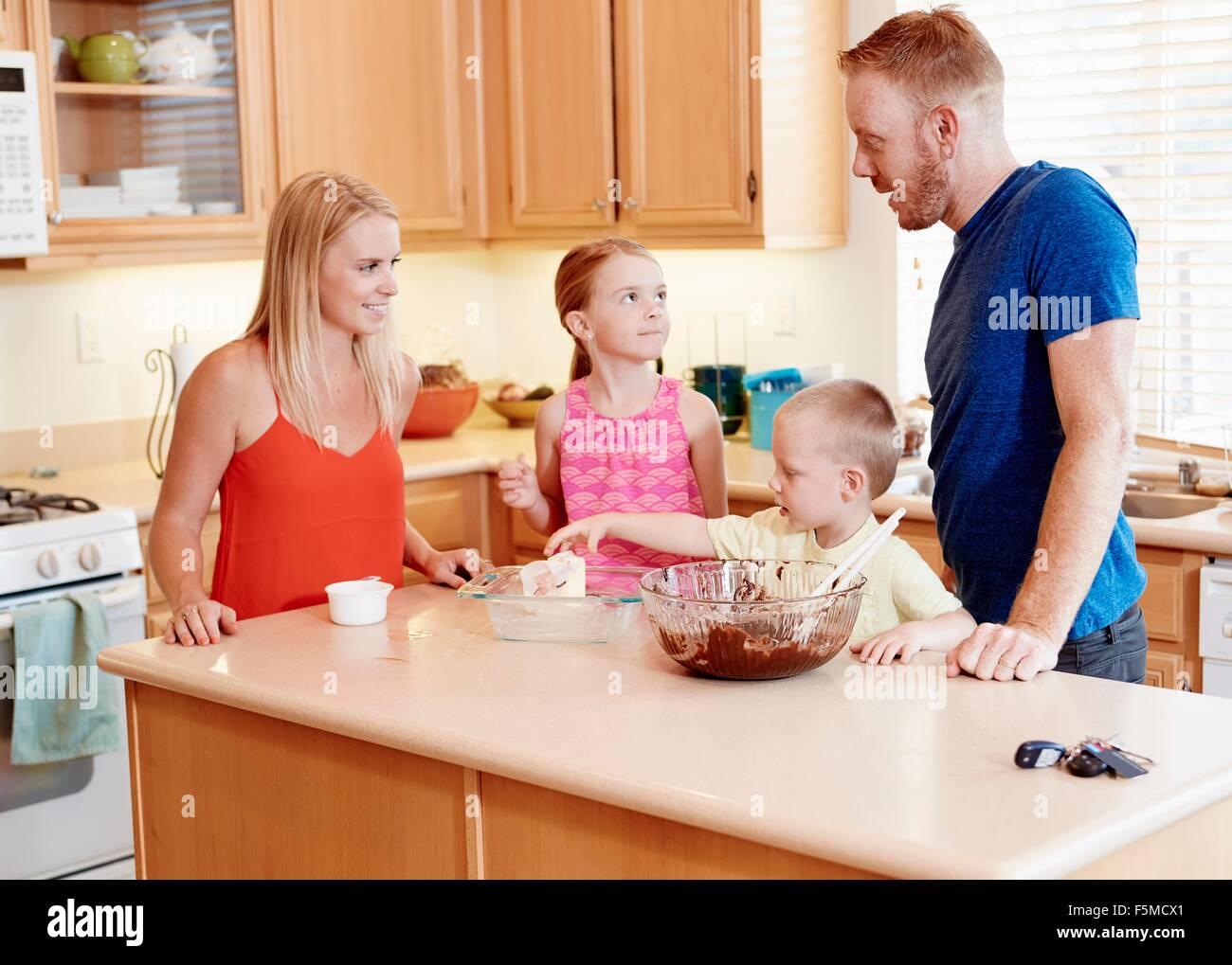 Family baking in kitchen Stock Photo