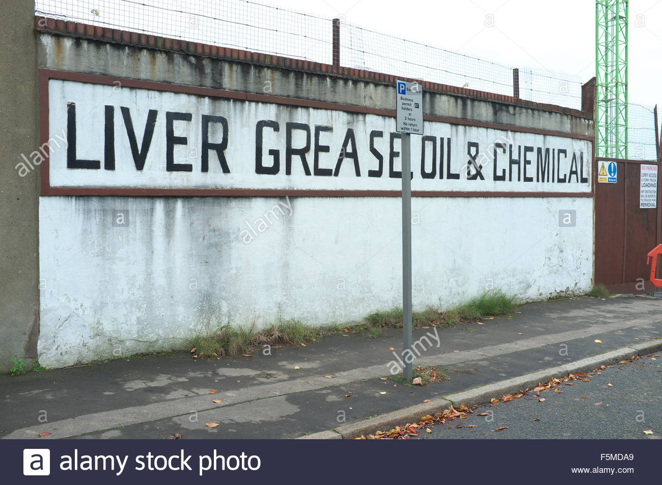 'Liver Grease Oil & Chemical' text painted on side of old manufacturing premises in central Liverpool, - Stock Image
