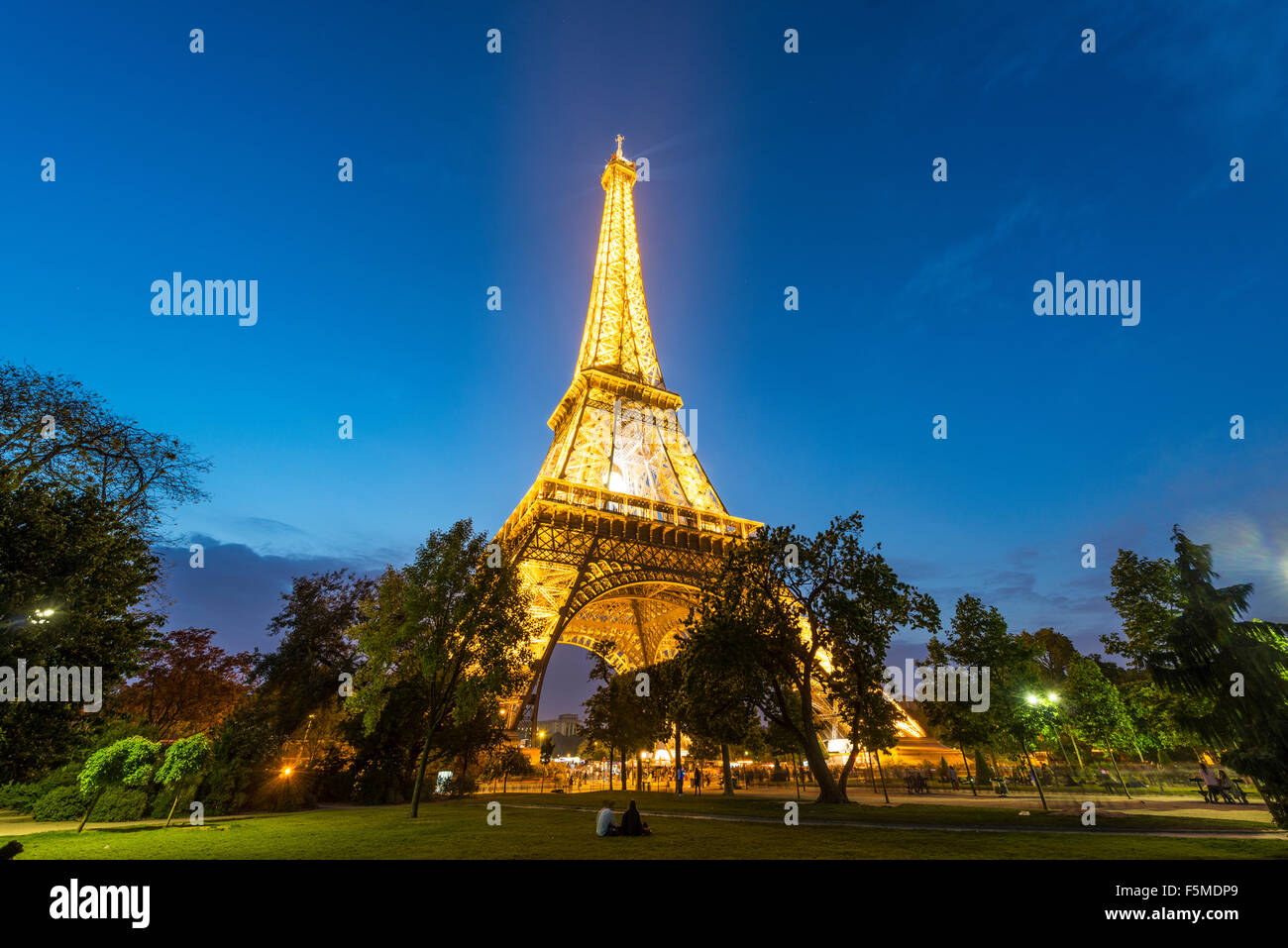 Illuminated Eiffel Tower at dusk, tour Eiffel, Champ de Mars, Paris, Ile-de-France, France Stock Photo