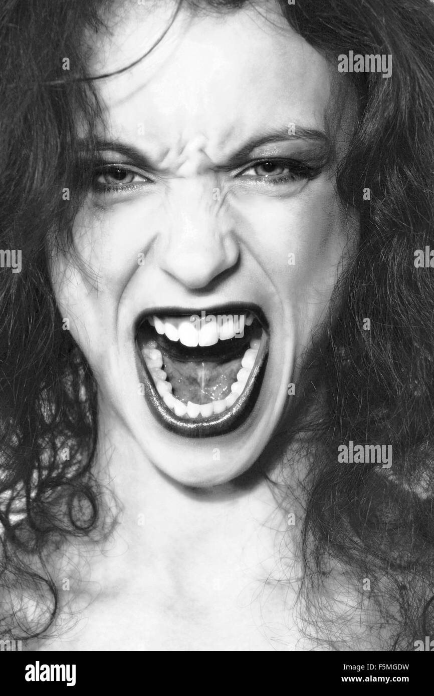 Black and white portrait of woman screaming