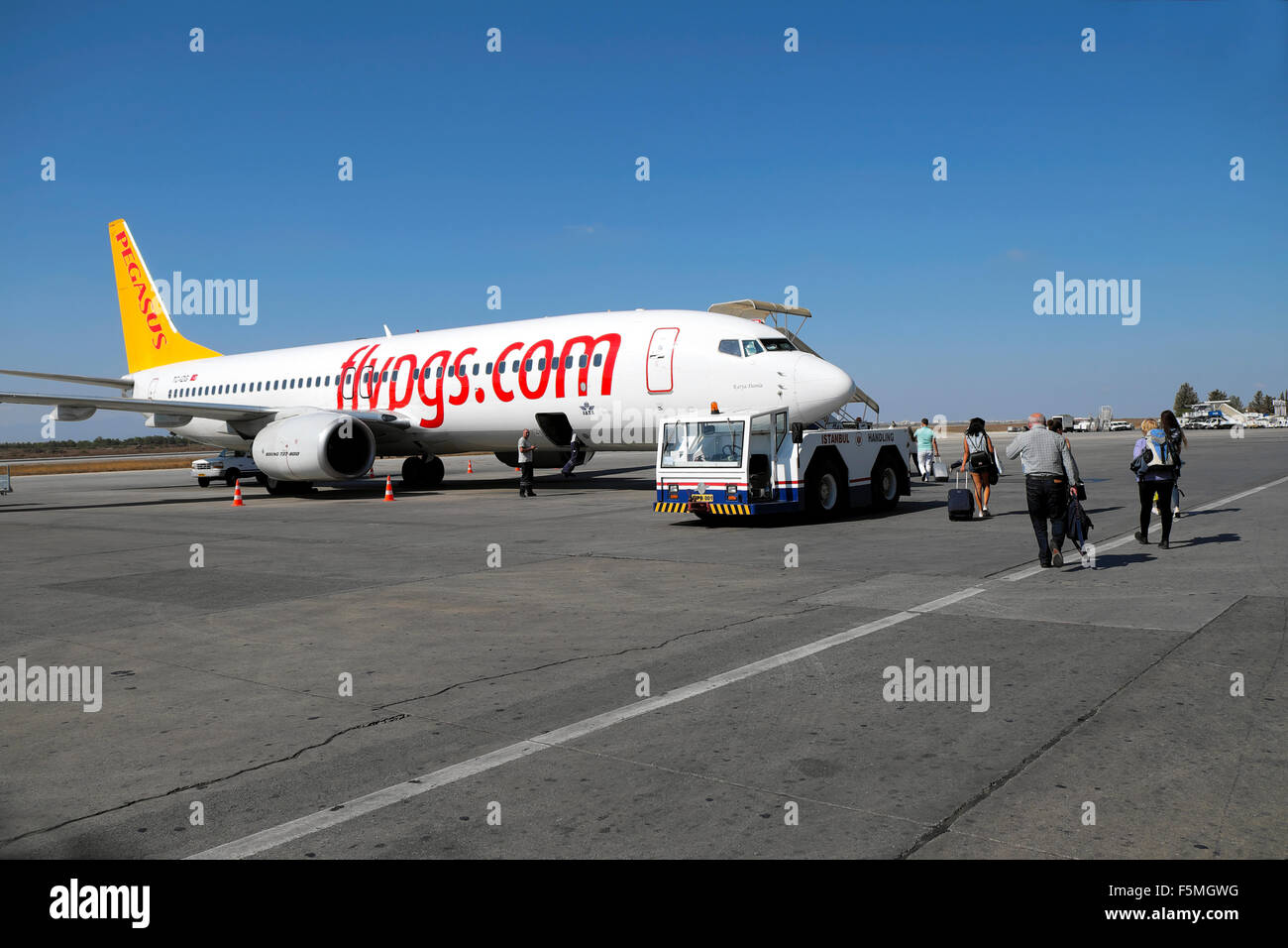 Passengers walking on the tarmac boarding a Pegasus airplane at Ercan airport in Nicosia North Cyprus  KATHY DEWITT - Stock Image