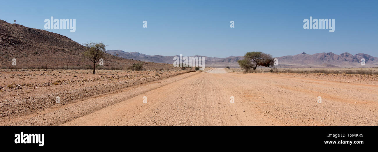 This road is the D707 a special road in Namibia. It leads into the Namib, one of the oldest deserts of this planet. - Stock Image