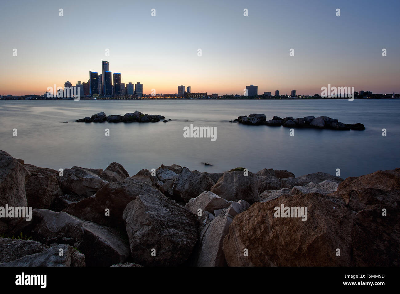 A landscape image of the Detroit River and Detroit, City skyline as seen from Windsor, Ontario Canada - Stock Image