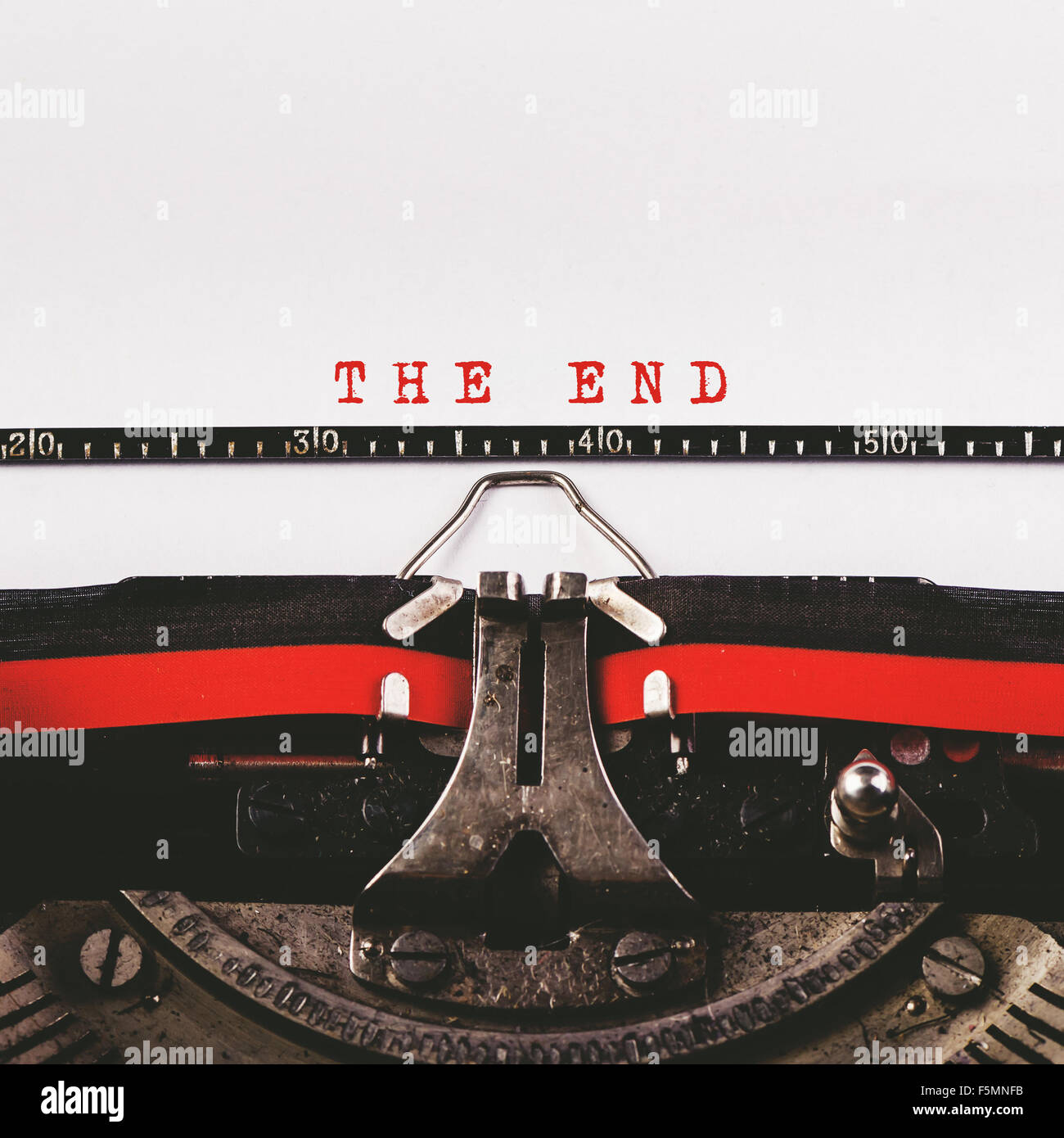The End text on old typewriter, retro toned conceptual image - Stock Image