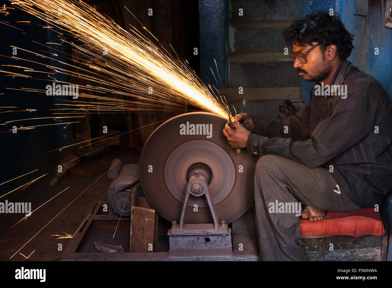 Sharpening tools in India the traditional way. - Stock Image
