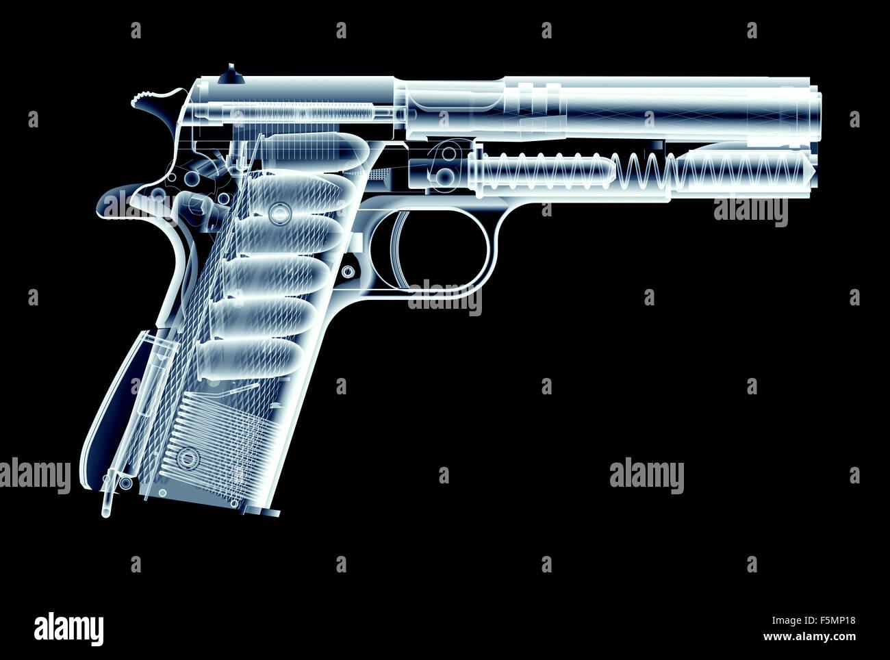 xray image of gun isolated on black background - Stock Image
