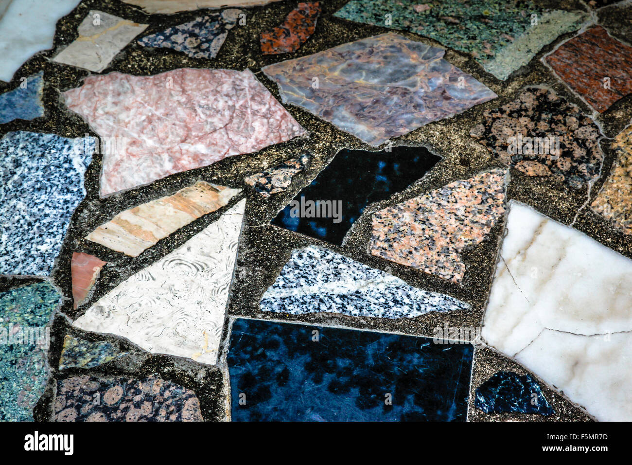Colorful, fanciful Close up detail of a mosaic tile composition of outdoor flooring - Stock Image